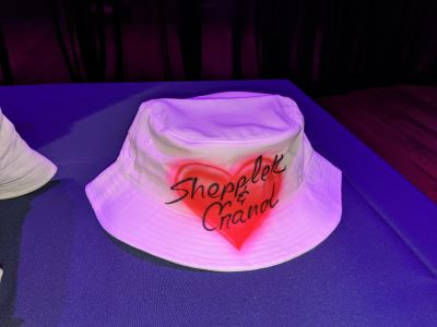 A airbrushed red heart on a bucket hat painted at a bat mitzvah at Armature Works