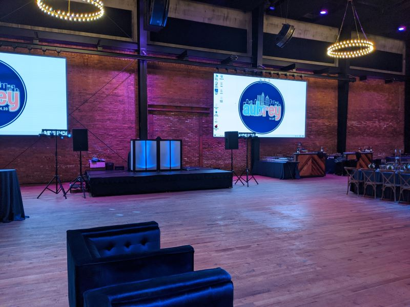 A wooden floor with exposed beams for a bat mitzvah event at Armature Works