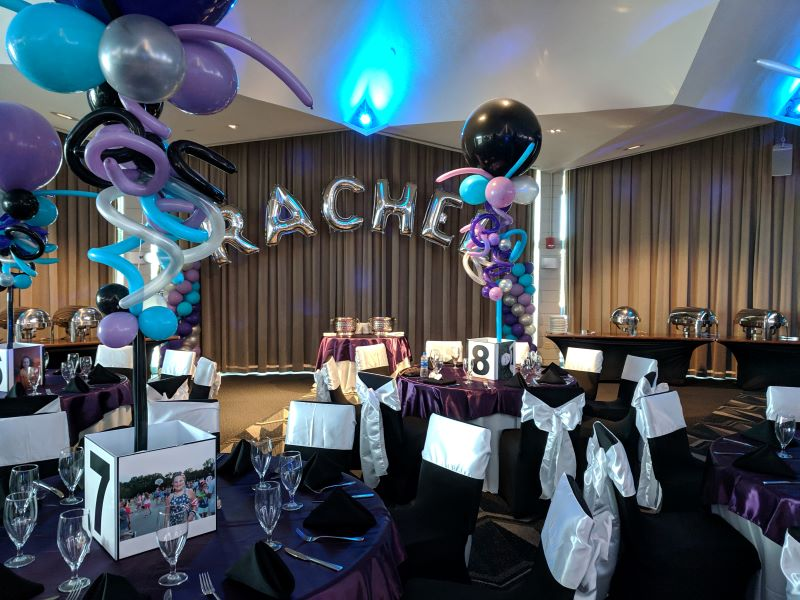 Balloons and streamers decorate a room for a bat mitzvah
