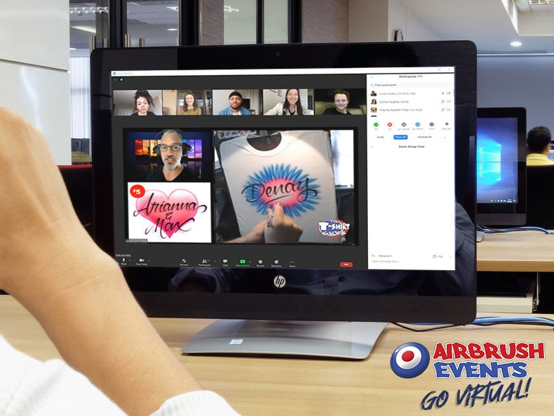 a computer sits on a desk with a virtual_airbrush_event on the screen
