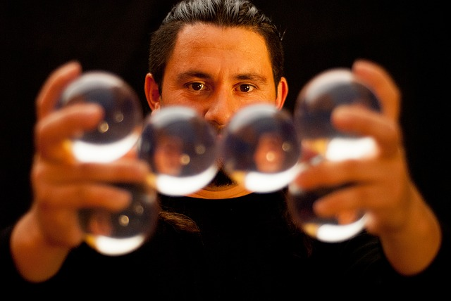A man juggling glass balls close to the camera- Best Virtual Entertainment Ideas for Your Online Event