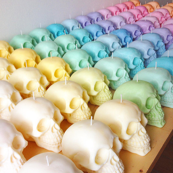 pastel colored skull candles lined up - 10 halloween themes